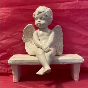 Ceramic Angel Sitting on a Bench